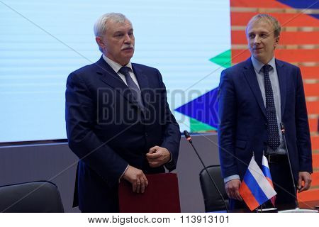 ST. PETERSBURG, RUSSIA - DECEMBER 16, 2015: Governor of St. Petersburg G. Poltavchenko (left) and Director of infrastructure of JSC MegaFon A. Titov sign the agreement on creation of Virtual Museum