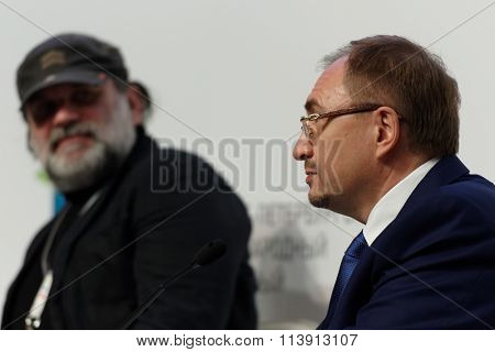 ST. PETERSBURG, RUSSIA - DECEMBER 16, 2015: Rector of St. Petersburg State University Nikolay Kropachev (right) and theater director Andrey Moguchy during St. Petersburg International Cultural Forum