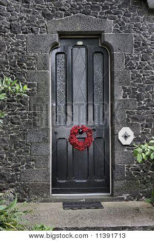 Christmas wreath on door of historic Kinder House