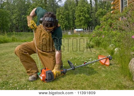 Man Operating String Trimmer