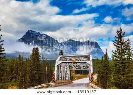 Bridge over the river in the picturesque mountain reserve.  Canadian Rocky Mountains, Jasper National Park