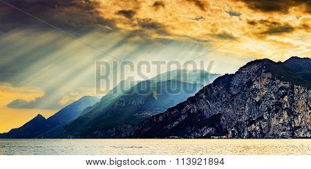 Panorama of Garda Lake at dramatic sunset, Lago di Garda Italy