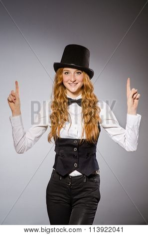 Pretty girl wearing retro hat isolated on gray