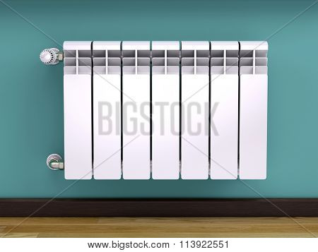 White contemporary heating radiator with thermostat isolated on white