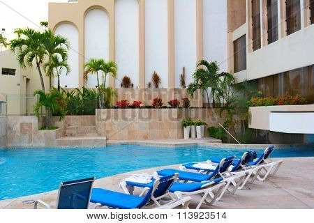 IQUITOS, PERU - OCTOBER 17, 2015: El Dorado Plaza Hotel pool. The El Dorado is the only luxury accommodation in Iquitos.