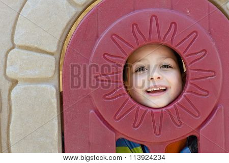 Child In Playhouse Window