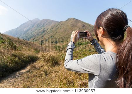 Woman use of the digital camera for taking photo