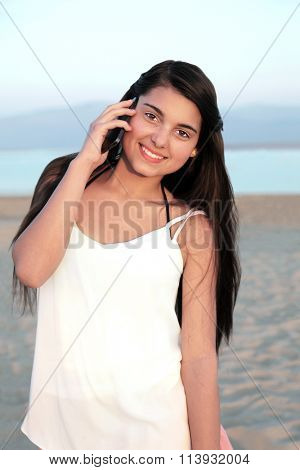 Beautiful young european teenage girl on a cell phone.