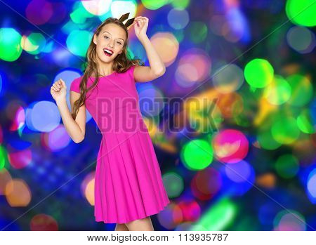 happy young woman or teen girl with princess crown