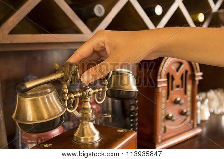Hand holding up a vintage handset