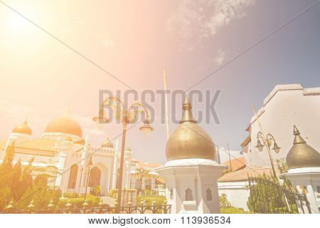 Bright mosque, Islam religious buildings in day in Penang, Malaysia, Asia.