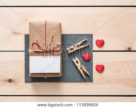 Gift box with white blank tag and hearts.