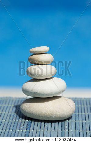 Zen stones on bamboo straw mat