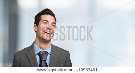 Portrait of a businessman having a good laughter. Large copy-space