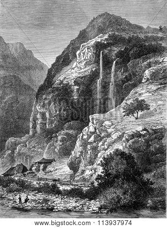Waterfall at La Balme-de-Thuy, Haute-Savoie, vintage engraved illustration. Magasin Pittoresque 1880.