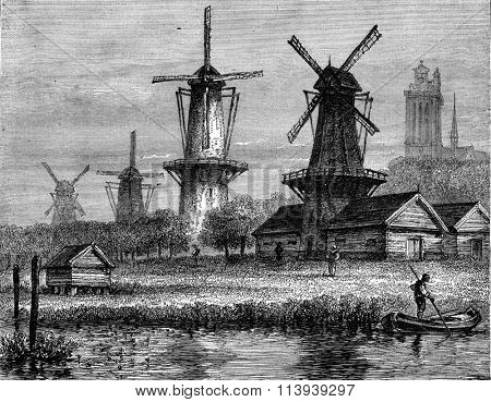 Windmills in Dordrecht, Holland, vintage engraved illustration. Magasin Pittoresque 1877.
