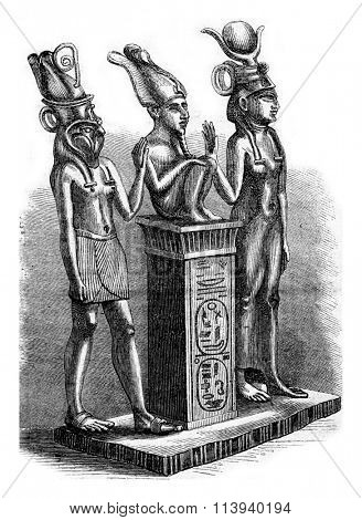 Louvre Museum, Isis, Osiris and Horus, vintage engraved illustration. Magasin Pittoresque 1873.