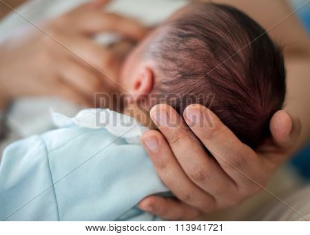 Newborn baby first days drinking breast milk
