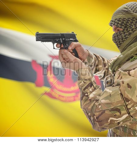Male In With Gun In Hand And National Flag On Background - Brunei