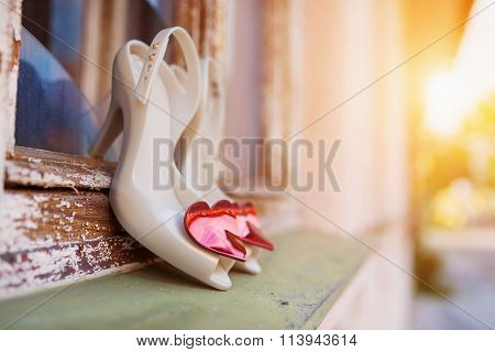 Bridal shoes on window parapet