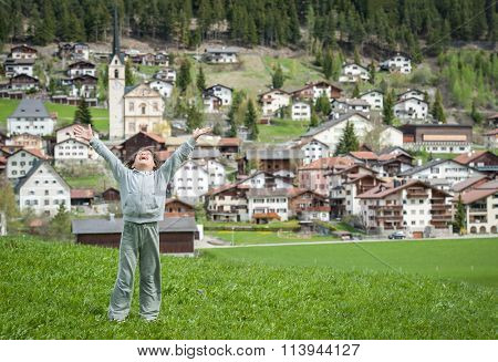 Kid enjoying Swiss coutryside in idyllic Alps