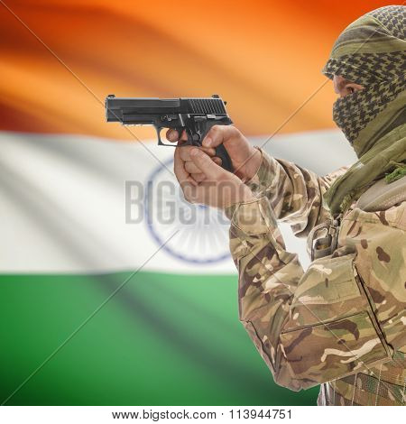 Male In With Gun In Hand And National Flag On Background - India