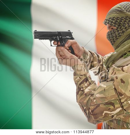 Male In With Gun In Hand And National Flag On Background - Ireland