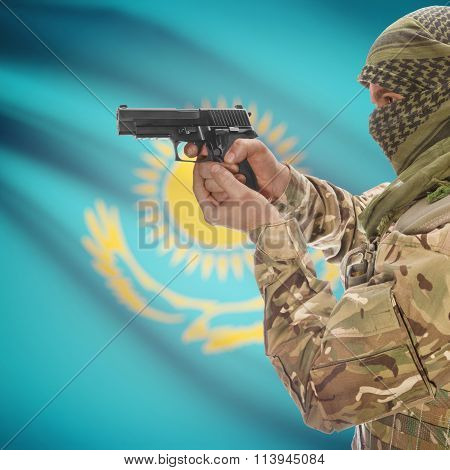 Male With Gun In Hand And National Flag On Background - Kazakhstan