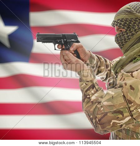 Male In With Gun In Hand And National Flag On Background - Liberia