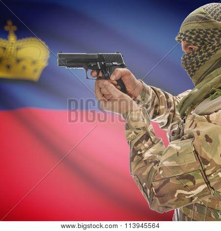 Male With Gun In Hand And National Flag On Background - Liechtenstein