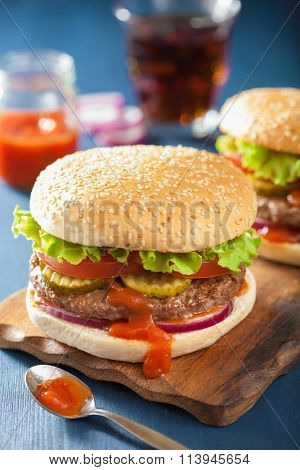 burger with beef patty lettuce onion tomato ketchup