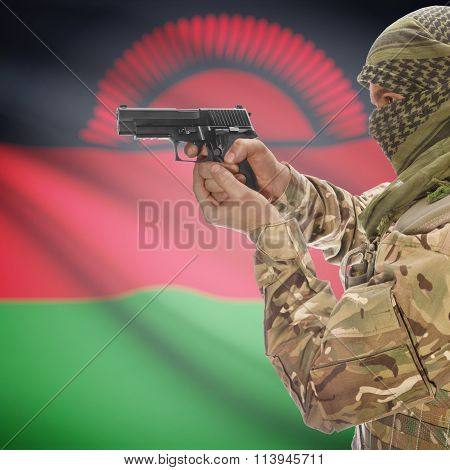 Male In With Gun In Hand And National Flag On Background - Malawi