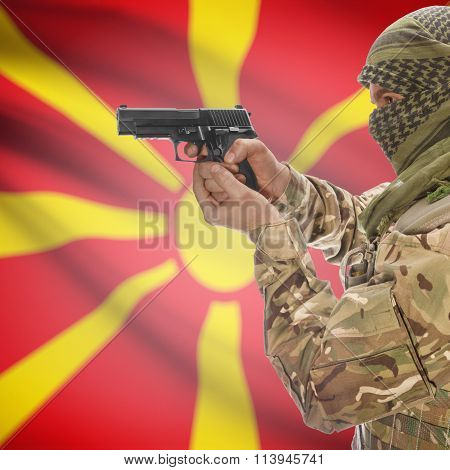 Male In With Gun In Hand And National Flag On Background - Macedonia