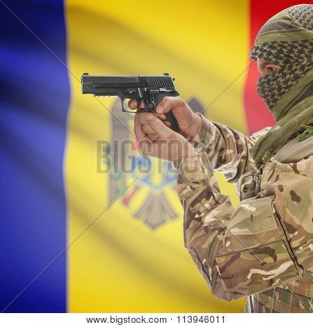 Male In With Gun In Hand And National Flag On Background - Moldova