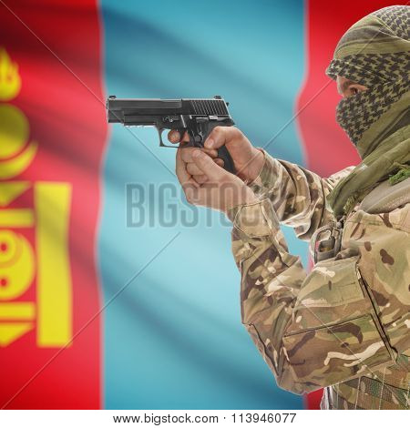 Male With Gun In Hand And National Flag On Background - Mongolia