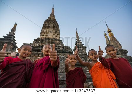 Unidentified young Buddhism novices at Bagan Area show thumb up