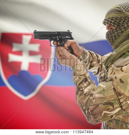 Male With Gun In Hand And National Flag On Background - Slovakia