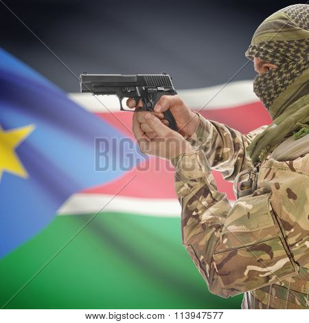 Male In With Gun In Hand And National Flag On Background - South Sudan