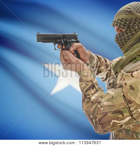 Male With Gun In Hand And National Flag On Background - Somalia
