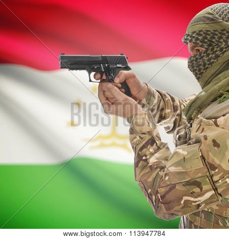 Male With Gun In Hand And National Flag On Background - Tajikistan