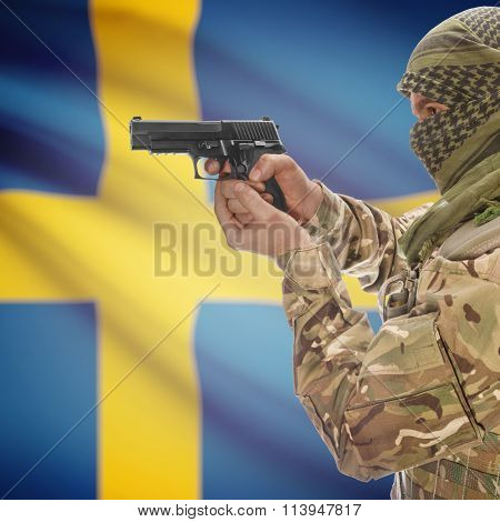 Male With Gun In Hand And National Flag On Background - Sweden