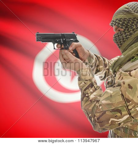 Male With Gun In Hand And National Flag On Background - Tunisia