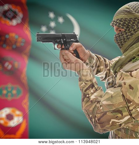 Male With Gun In Hand And National Flag On Background - Turkmenistan