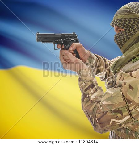 Male With Gun In Hand And National Flag On Background - Ukraine
