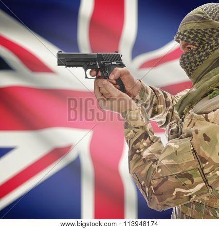 Male With Gun In Hand And National Flag On Background - United Kingdom