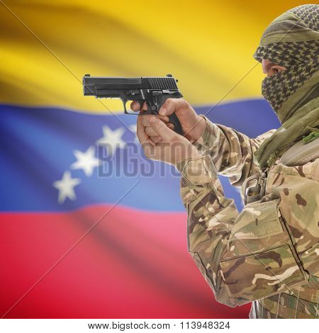 Male With Gun In Hand And National Flag On Background - Venezuela