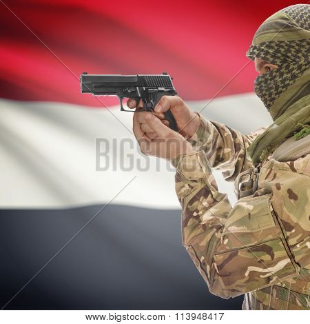 Male With Gun In Hand And National Flag On Background - Yemen
