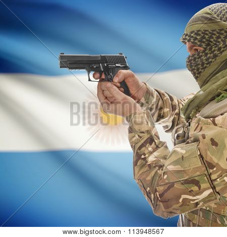 Male In With Gun In Hand And National Flag On Background - Argentina
