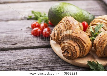 Fresh croissants, cereals with flax seeds, vegetables and herbs