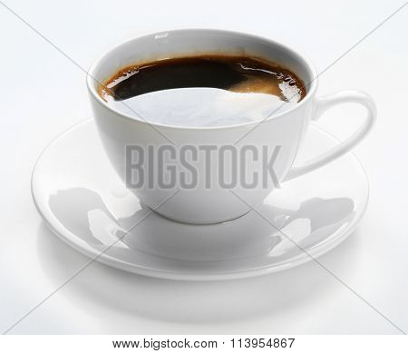 A cup of tasty coffee, isolated on white